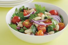 Planning a Saturday barbie? This delicious combination of cannellini beans, tomatoes and herbs in a zesty vinaigrette is great with barbecued meat.