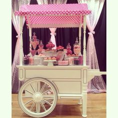 Pink candy and dessert cart