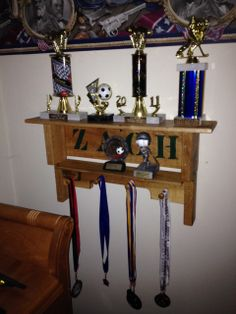 You've seen pallets near dumpsters for years. They may look like trash to some but for men with imaginative minds and crafty hands, pallets can be turned into treasures like this trophy shelf for a boy. It's a pretty cool piece of work. To order one for your child and check out what else is being handmade, visit RMT designs on Facebook: https://www.facebook.com/pages/RMT-Designs/1416854978587445
