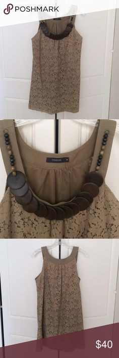 """Tribal inspired lace minidress Army green lace minidress with attached wooden necklace embellishment.  100% cotton.  Slips over your head.  Measures 32"""" from top of shoulder. Lined. Theme Dresses Mini"""