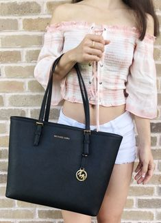 The Michael Kors Carryall Jet Set Travel Medium Black Saffiano Leather Tote is a top 10 member favorite on Tradesy. Michael Kors Jet Set, Michael Kors Hamilton, Travel Outfit Summer, Travel Tote, Travel Packing, Fashion Designer, Mini, Tote Bag, Clutch Bag