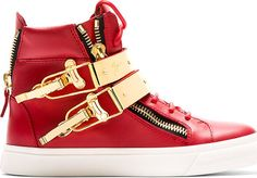 Buffed leather high-top sneakers in red. Round toe. Tonal lace-up closure. Logo patch at bellows tongue. Signature zipper accents at eyerow and heel. Straps at vamp with metal accent plaques in gold-tone and flip clasp closures. Tonal stitching. White rubber sole.