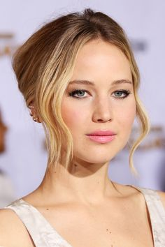 All The Best Looks From The Mockingjay Red Carpet #refinery29  http://www.refinery29.com/2014/11/78195/hunger-games-mockingjay-premiere-pictures#slide1  We're digging Jennifer Lawrence's bronzed skin and flirty pink lipstick, which she toughened up with some inky black eyeliner.