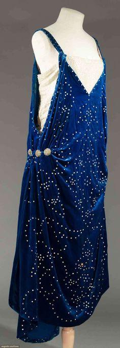 "RHINESTONE & VELVET EVENING DRESS, c. 1924 |  May 9, 2017  Sturbridge, Massachusetts |  Sapphire velvet studded w/ rhinestones, lame under bodice, B 32"", H 36"", L 50""-53"", (missing stones, lame pulls, pink lining added & stained) very good. MCNY"
