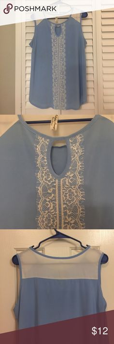 Lace front tank Beautiful baby blue tank for summer ! Casual or business . Polyester & sheer on shoulders .gently used . Tops Blouses