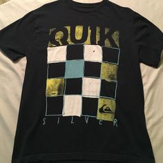 Men's quiksilver top! This black quiksilver shirt is in excellent condition! From a smoke free home no rips or stains! It features a distressed checkered grid with quik silver written on the front! I will make a custom bundle with 15% off if interested in more than one item! Quiksilver Tops Tees - Short Sleeve