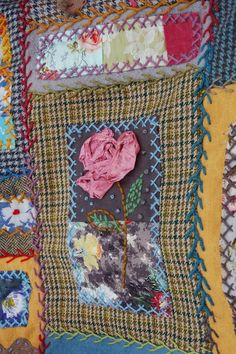 detail of blanket - vintage dyed ribbon manipulated and stitched to form rose. Teresa Searle 2013
