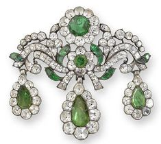 A paste girandole brooch/pendant, 2nd half of the 18th century    Of scrolled foliate design with two flowerhead motifs, suspending three detachable pear-shaped drops, set throughout with circular and cushion-shaped colourless and foiled green paste, all within closed-back settings, length 7.3cm., Harvey and Gore case. Estimate: £2,000 - 3,000