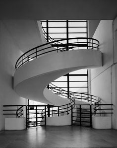 I like the metal railing.  Our staircases won't be curved like this, but our balconies potentially could be.  Art Deco Interior - Béton Brut. @Deidré Wallace