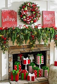Beautiful red and green Christmas mantle. DIY mantle with greenery, Wreath and presents below.