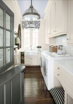 Traditional Laundry Room with Pendant Light, Hardwood floors, Crown molding, Farmhouse Sink, Dutch door, Built-in bookshelf