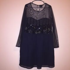 ASOS Party Dress Gently used. Marked as a 20 but think it could also fit a larger busted 16-18. Bust is 22inches. Length is 41inches. Button closure on the top in the back. Black liner. Sheer top half. Two small holes on the bottom of the sleeve. HARDLY noticeable. A few missing sequins. Sooo perfect for Xmas parties or New Years! Any questions? Just ask ✌️ ASOS Dresses