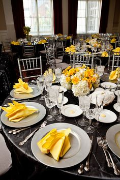 Wonderfully decorated yellow and gray table for a wedding!
