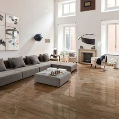"Jungle Lux Brown High gloss and rich deep finish Rectified porcelain wood, Highly resistant to wear, stains and acids Like walking on a piano Size: 8""x48"" Available in 5 Colors Dark Nut Honey Cherry Brown"