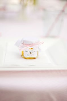 It is all in the details- honey favors. My own bridal shower brunch. Photos by Connie Dai Photography. Flowers by Cori Cook Floral.