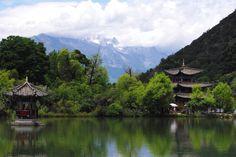 Jade Dragon Snow Mountain towers above Lijiang Yunnan China