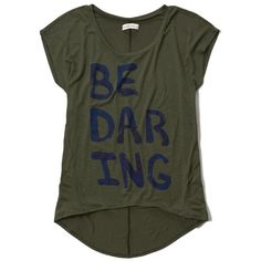 Abercrombie & Fitch Be Daring Hi Lo Graphic Tee ($21) ❤ liked on Polyvore featuring tops, t-shirts, olive, army green t shirt, graphic tees, stretch t shirt, graphic design tees and olive tops