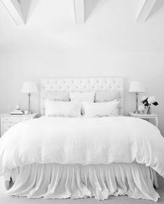 Love this white on white bedroom.
