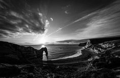 Durdle Door in black and white I quite like my black and white sunset pictures like this one processed using Snapseed on my iPhone whilst sat on a rock waiting for the sun to appear again!! #architecturalphotographer #buildingphotographer #commercialphotographer #constructionphotographer #constructionproductphotographer #industrialphotographer #interiorphotographer #landscapephotographer #professionalphotographer #propertyphotographer #photographer #productphotographer #dorset #hampshire…