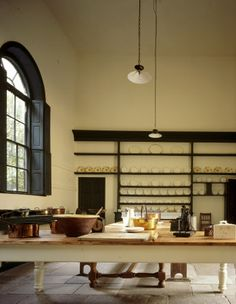 Great Kitchen showing large arched window and plate-shelves at Ormesby Hall, Yorkshire, UK.  nationaltrustimages.org.uk