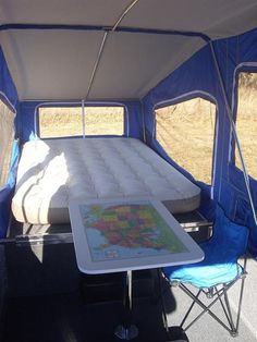 love the idea of putting a map on our tent trailer table