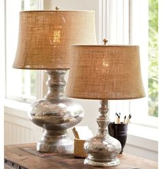 The warm luster of mercury glass highlights the curved silhouette of these cottage-style lamps. #afflink