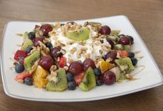 Fruit & Nut Salad with Greek yogurt and raw honey drizzled over top! Healthy and amazing!