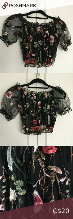 NWOT Black Embroidered Floral Crop Top Black embroidered floral crop top. It can be worn off the shoulder or on the shoulder because there are elastics inside the seams. New without tags.  Please message me for exact measurements before you buy if you are unsure!    Smoke-free home! Tops Crop Tops Floral Crop Tops, Black Crop Tops, Plus Fashion, Fashion Tips, Fashion Trends, Off The Shoulder, Ruffle Blouse, Smoke Free, Tags