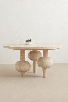 Kalasha Dining Table With its strong, sculptural presence, this handcarved table is finished in a gray wash wax that enhances the wood's natural knot and grain. Even better, its urn-shaped legs create a substantial feel without taking up extra room. Unique Furniture, Dining Furniture, Luxury Furniture, Furniture Design, Rustic Furniture, Legs For Furniture, Futuristic Furniture, Plywood Furniture, Furniture Stores