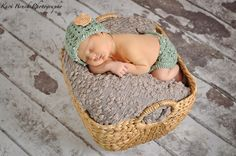 Newborn baby girl studio session. Newborn inspiration for baby pictures with hand made hats and diaper covers. Image by Kari Bruck Photography.