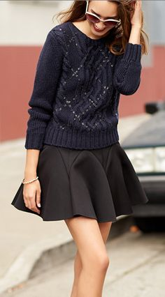 navy cable-knit sweater with black skater skirt