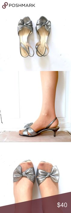 Kate Spade Silver Bow Kitten Heels. 7.5 These Kate Spade kitten heels are beautiful and they just don't fit my feet. They have been worn (see bottom), but they are in great condition.  Price reflects wear on bottom, but shoes are otherwise flawless. Kate Spade Shoes Heels