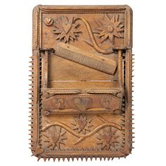 Carved Comb Box | Tramp art comb box, delicately carved wood wall hanging with flower and heart motifs.  From a unique collection of antique and modern sculptures and carvings at http://www.1stdibs.com/furniture/folk-art/sculptures-carvings/