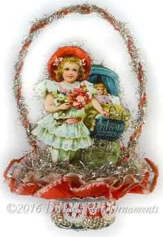 Dresden Star Ornaments - Reserved for Diana –Victorian Girl with Baby Carriage in Double-Ruffle Valentine Nut-Cup , SOLD (http://www.victorianornaments.com/reserved-for-diana-victorian-girl-with-baby-carriage-in-double-ruffle-valentine-nut-cup/)