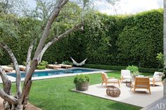 Nothing too ostentatious, just some lovely green grass, a decent sized pool and an outdoor lounging area.