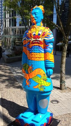 Decorated terracotta man, all sold for charity in downtown Vancouver