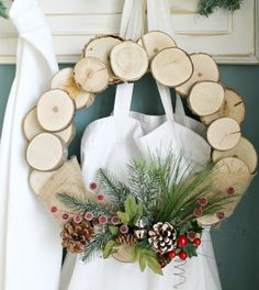 A while back I tagged along with my mother-in-law to a holiday craft day at her church and I made this rustic wood wreath out of slices of. Holiday Wreaths, Holiday Crafts, Christmas Crafts, Christmas Decorations, Holiday Decorating, Beach Christmas, Xmas, Woodworking For Kids, Woodworking Furniture