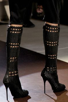 I wouldn't mind having a pair of those boots in my wardrobe, they are definitely unique!