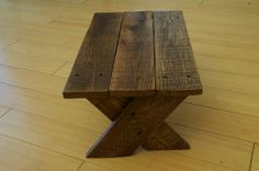 This handmade stool has a simple design and is crafted from reclaimed pallet wood. It is small enough to tuck away in a closet or small nook, but big enough to make it easy to access objects that are just a little too far out of reach. This step stool is also great for kids to use in bathrooms or kitchens. The stool comes with a rustic walnut stain and polyurethane coating, giving it an aged look while remaining durable. Dimensions and stain color can be customized upon request.
