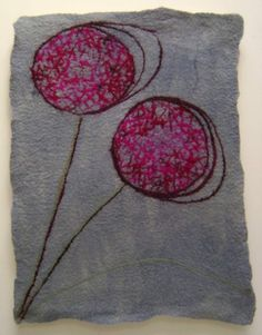 pink seedhead on blue