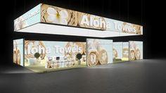 357 Textilien Aloha Towels | Eindruckvoller Messestand für einen Hersteller von Textilien.   Der hinterleuchtete Deckenring mit Wellness Motiv und Logodruck macht den grossen Eck...