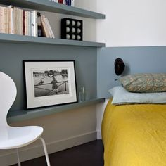 This shelf acts as a nightstand.  I also love the painted stripe between the shelves.
