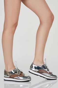 Pointed toe oxfords with classic lace up closure. Metallic finish with  contrast clear panels for 0ced44feb715