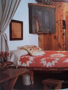 Country Bedroom...with prim wall cupboard & old quilt on the bed.