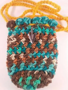 Check out this item in my Etsy shop https://www.etsy.com/listing/509025410/crocheted-amulet-necklace-pouch-beaded