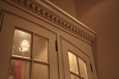 crown moulding accented with dentil moulding