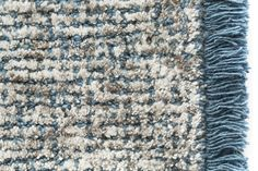 Blue Tweed carpet with fringes. Interior design textiles by Casalis. http://www.casalis.be/