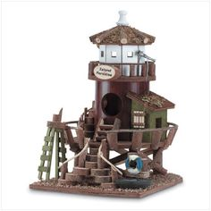 "Lighthouse Station Birdhouse ""Lighthouse Station"" birdhouse. Wood. 10 7/8"" x 8 1/2"" x 10 1/2"" high."