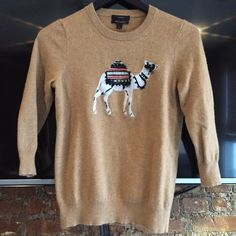 J crew 3/4 sleeve tan camel sweater small Really cute sweater! Pre loved condition. Size small.55% wool/ 30% nylon / 15% cashmere J crew Sweaters Crew & Scoop Necks