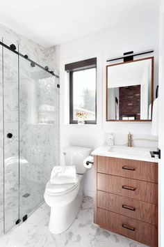 Bathroom by Madeleine Design Group, part of an award-winning Luxury Laneway home renovation in Vancouver, BC.